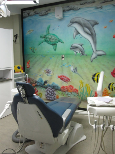 Air brush painting of dolphin in kid's operatory